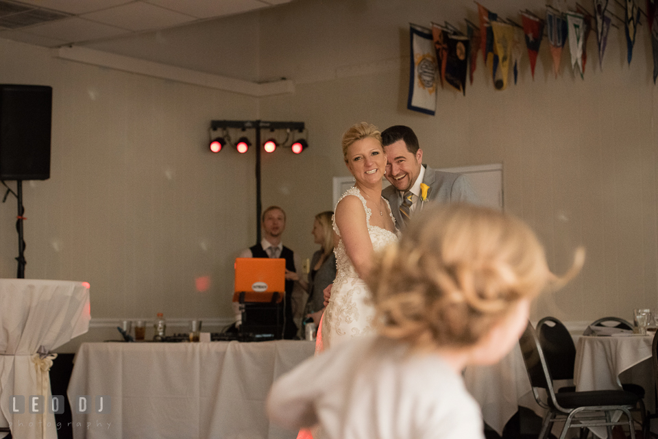 Bride and Groom laughing watching their little girl dancing. Maryland Yacht Club wedding at Pasadena Maryland, by wedding photographers of Leo Dj Photography. http://leodjphoto.com