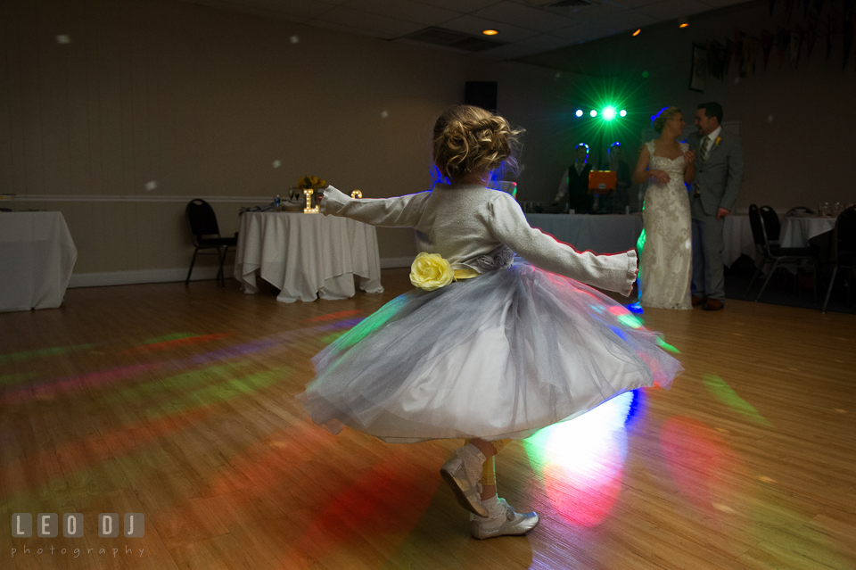 "Flower girl twirling around to the song  ""Let It Go"" from the Disney animate movie ""Frozen"". Maryland Yacht Club wedding at Pasadena Maryland, by wedding photographers of Leo Dj Photography. http://leodjphoto.com"