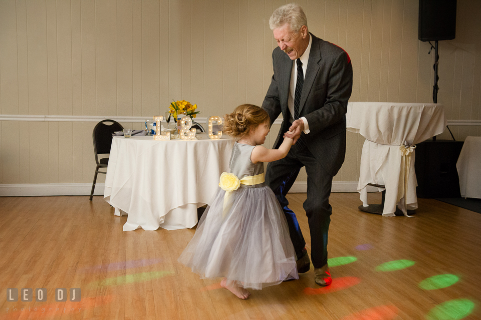 Flower girl dancing with her Uncle. Maryland Yacht Club wedding at Pasadena Maryland, by wedding photographers of Leo Dj Photography. http://leodjphoto.com