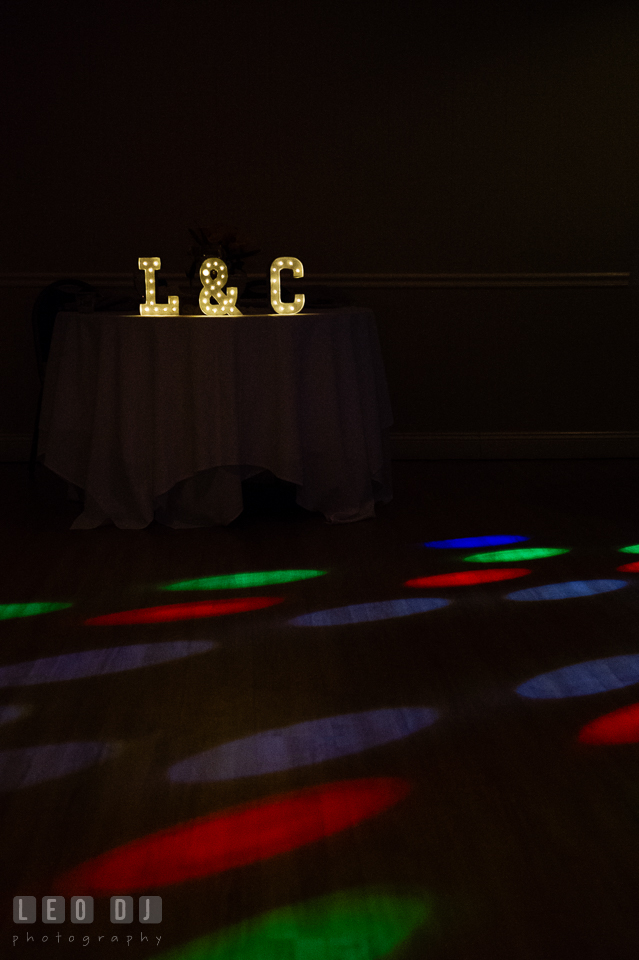 Initial of the Bride and Groom's names on the sweetheart table with colorful lights from the DJ. Maryland Yacht Club wedding at Pasadena Maryland, by wedding photographers of Leo Dj Photography. http://leodjphoto.com