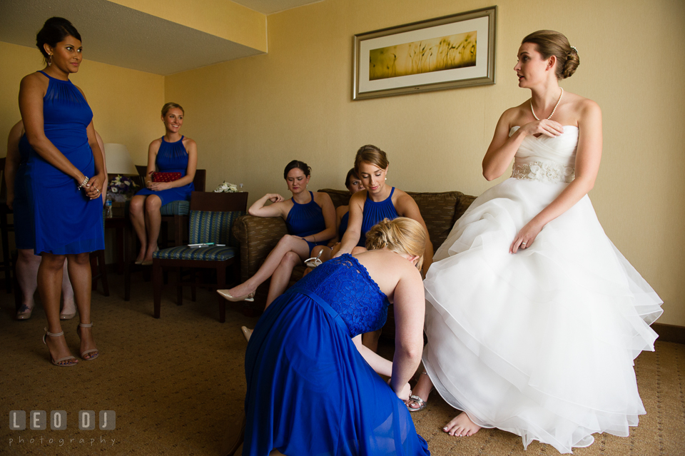 Embassy Suites Baltimore Hunt Valley Maid of Honor put shoes on Bride photo