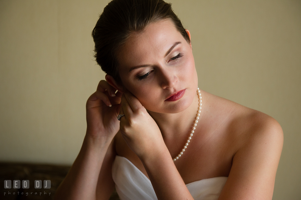 Embassy Suites Baltimore Hunt Valley Bride put on earrings photo