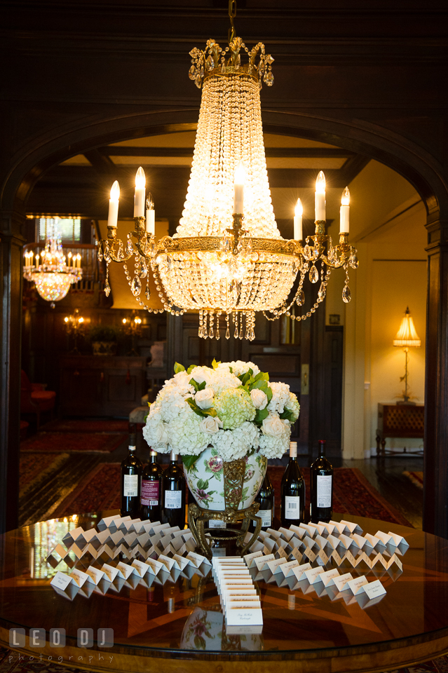 The Mansion at Valley Country Club table assignment cards under the chandelier photo