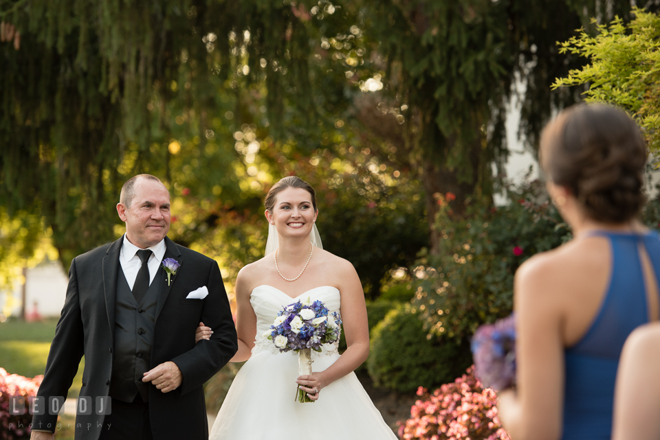 The Mansion at Valley Country Club Bride walking down the aisle escorted by Father photo