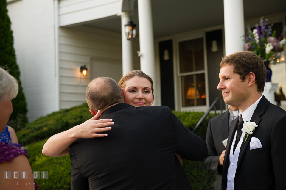 The Mansion at Valley Country Club Bride hugging Dad during ceremony photo
