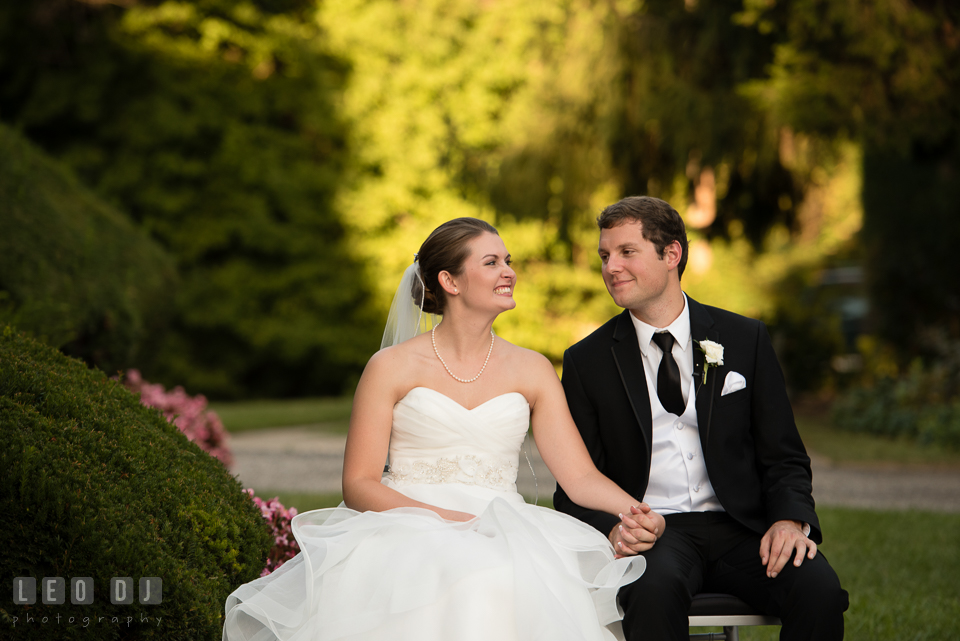 The Mansion at Valley Country Club Bride and Groom smiling together during ceremony photo by Leo Dj Photography