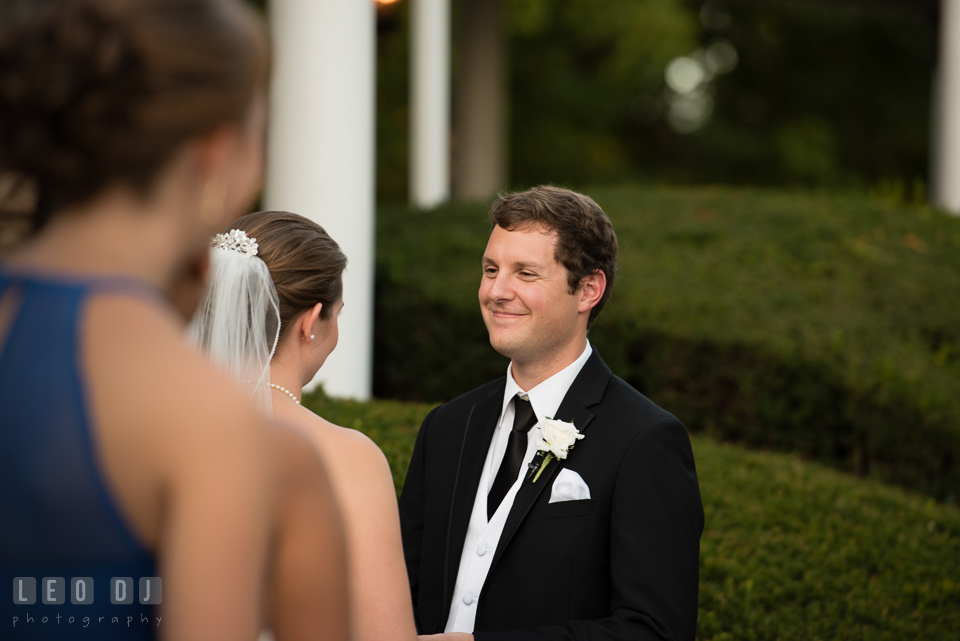 The Mansion at Valley Country Club Groom smiling during wedding vow photo