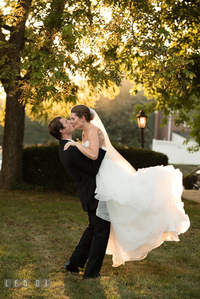 The Mansion at Valley Country Club Groom picked up and kissed Bride during sunset photo by Leo Dj Photography