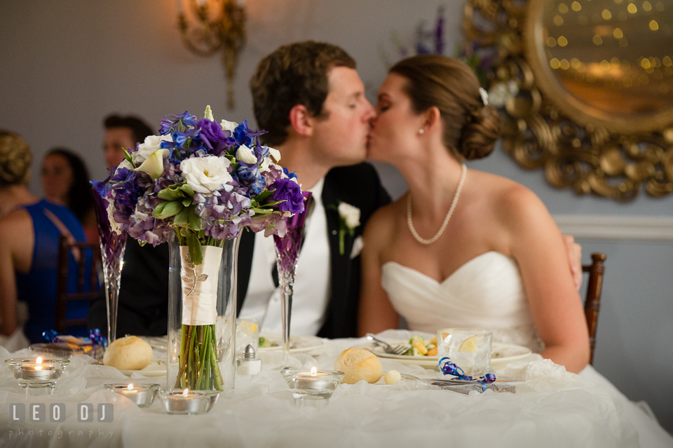 The Mansion at Valley Country Club newly wed couple kissed at sweetheart table photo by Leo Dj Photography