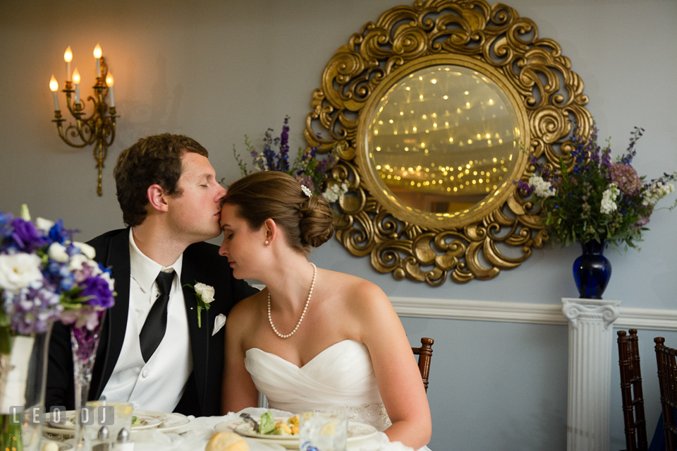 The Mansion at Valley Country Club Groom kissed Bride at sweetheart table photo by Leo Dj Photography