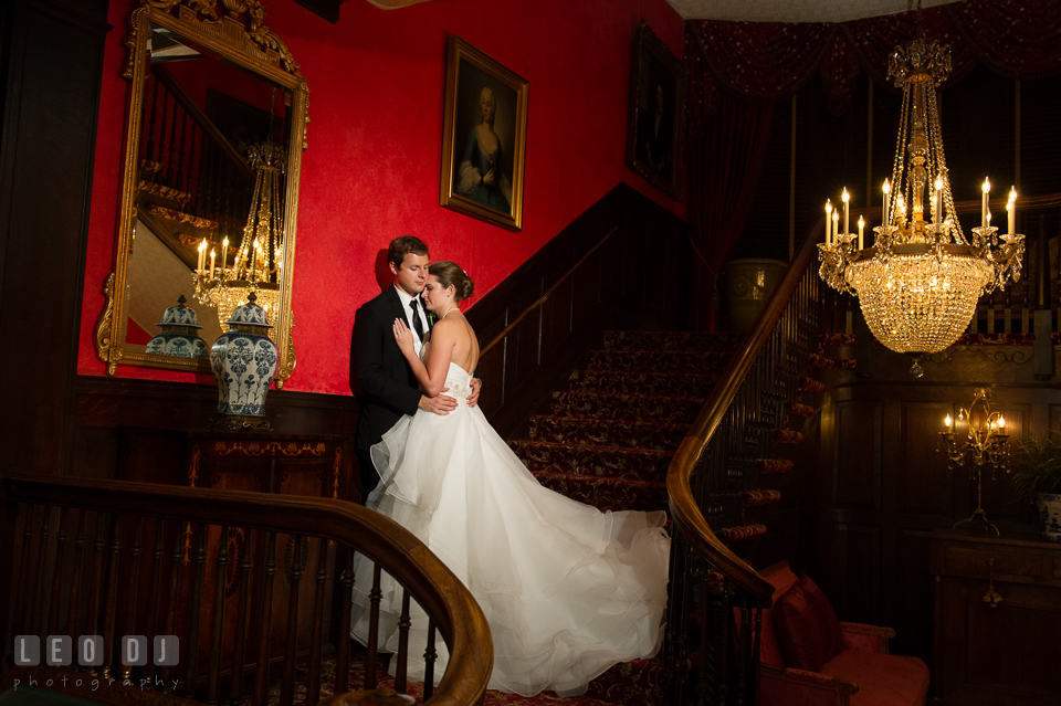 The Mansion at Valley Country Club Bride and Groom hugging on the stairs photo by Leo Dj Photography