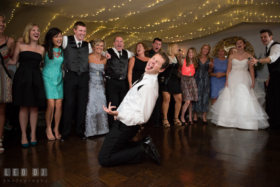 The Mansion at Valley Country Club Groom doing air guitar photo
