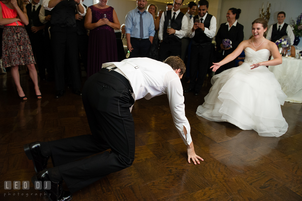 The Mansion at Valley Country Club Groom crawling to Bride photo