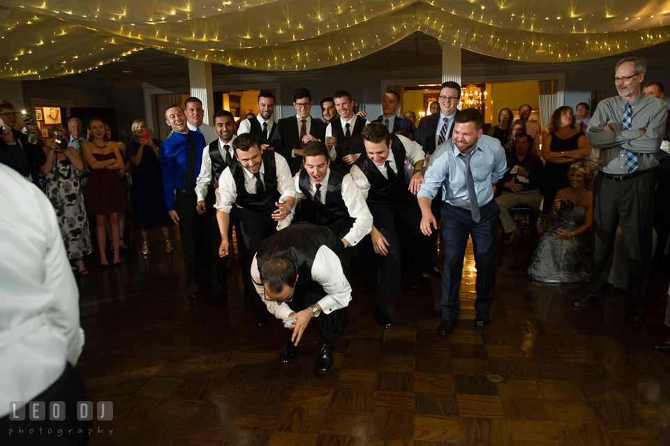 The Mansion at Valley Country Club Groomsman and guests trying to catch garter photo