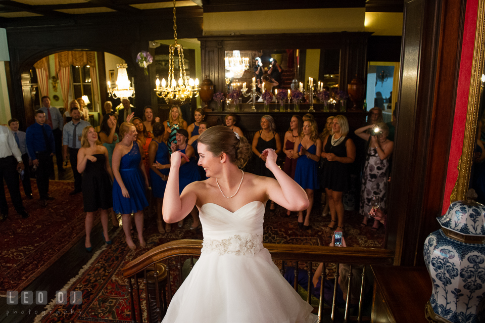 The Mansion at Valley Country Club Bride tossing bouquet to single ladies photo