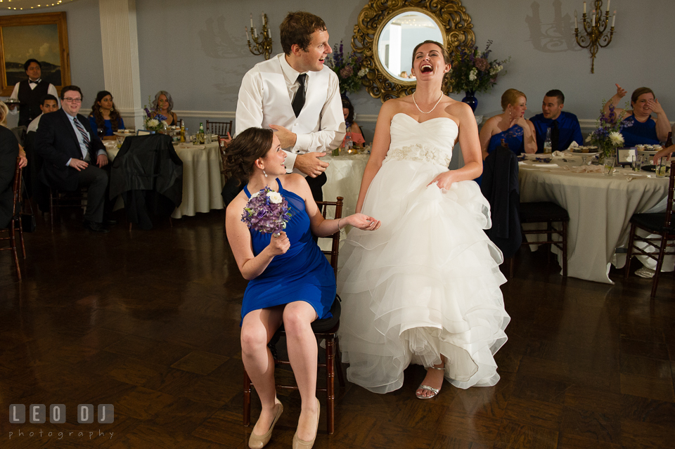 The Mansion at Valley Country Club newly wed couple laughed before putting garter photo