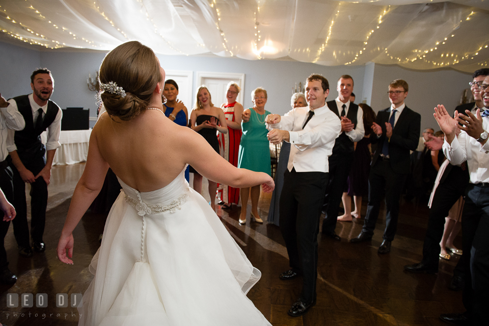 The Mansion at Valley Country Club Groom fishing and pulling Bride to dance photo
