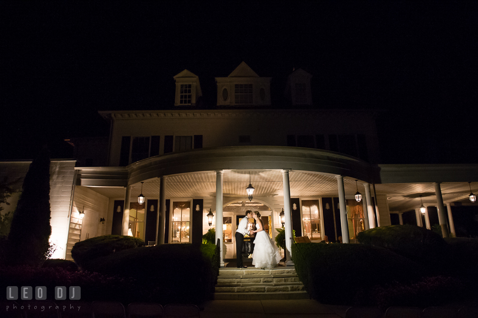 The Mansion at Valley Country Club newlywed couple kissing on the front porch photo by Leo Dj Photography
