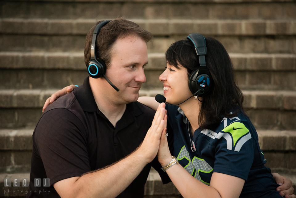 Engaged couple wearing gaming headset cuddling. Quiet Waters Park Annapolis Maryland pre-wedding engagement photo session, by wedding photographers of Leo Dj Photography. http://leodjphoto.com