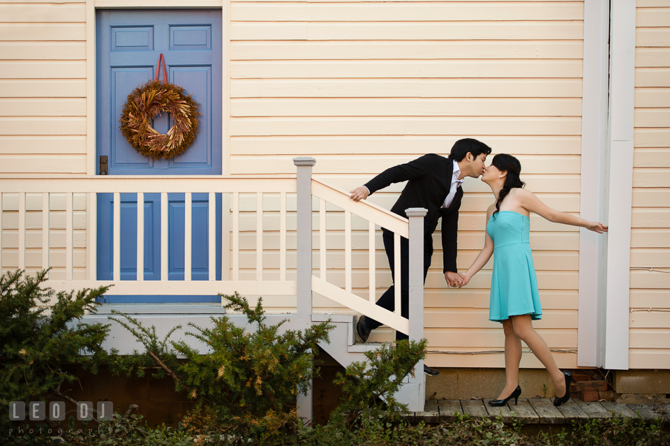 Engaged girl and her fiancé kissing by the stairs. Annapolis Eastern Shore Maryland pre-wedding engagement photo session at downtown, by wedding photographers of Leo Dj Photography. http://leodjphoto.com