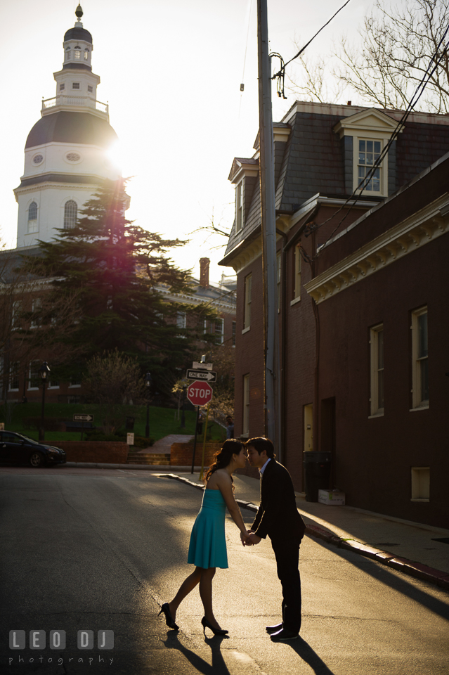 Silhouette shot of engaged couple holding hands by the Maryland State House. Annapolis Eastern Shore Maryland pre-wedding engagement photo session at downtown, by wedding photographers of Leo Dj Photography. http://leodjphoto.com