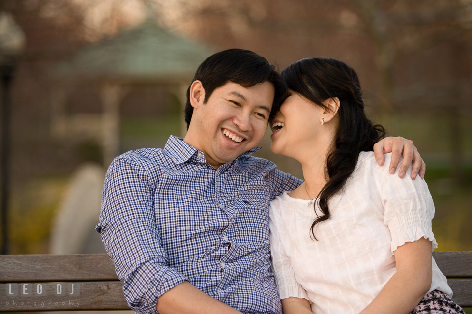 Engaged couple embracing and laughing together. Quiet Waters Park Annapolis Maryland pre-wedding engagement photo session, by wedding photographers of Leo Dj Photography. http://leodjphoto.com