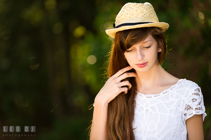 Beautiful girl with hat playing her long hair. Easton, Centreville, Maryland, High School senior portrait session by photographer Leo Dj Photography. http://leodjphoto.com
