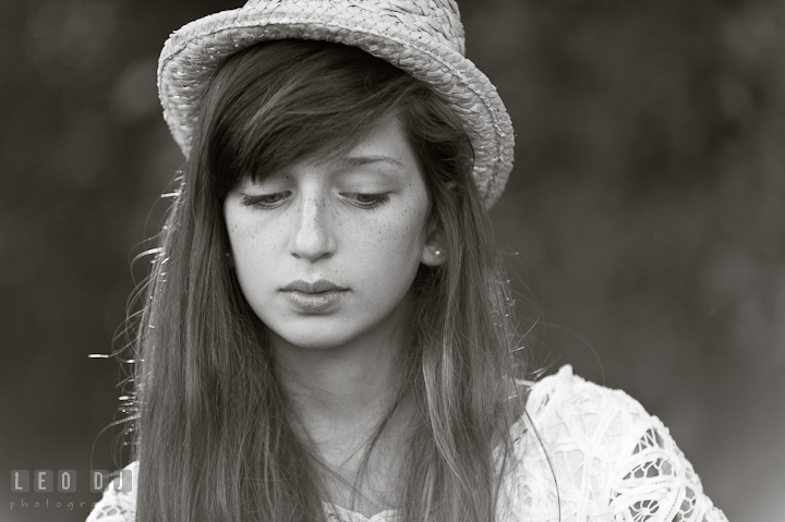 Girl with long hair and hat looking down. Eastern Shore, Maryland, High School senior portrait session by photographer Leo Dj Photography. http://leodjphoto.com