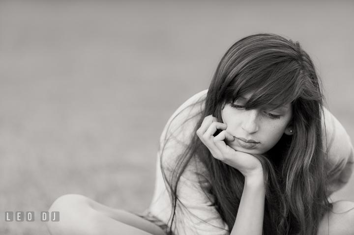 Pretty girl resting chin on palm. Eastern Shore, Maryland, High School senior portrait session by photographer Leo Dj Photography. http://leodjphoto.com