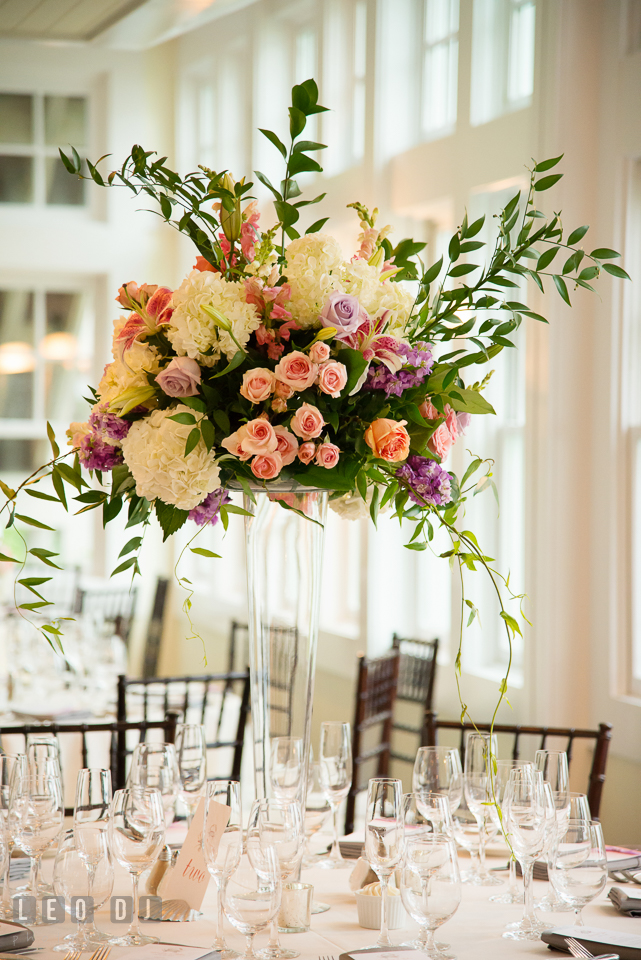 Tall elegant vase flower table centerpiece by Lauren Niles and My Flower Box Events. Kent Island Maryland Chesapeake Bay Beach Club wedding photo, by wedding photographers of Leo Dj Photography. http://leodjphoto.com