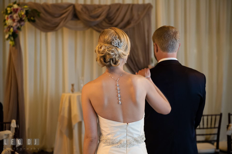 Bride holding Groom's shoulder during first look. Kent Island Maryland Chesapeake Bay Beach Club wedding photo, by wedding photographers of Leo Dj Photography. http://leodjphoto.com