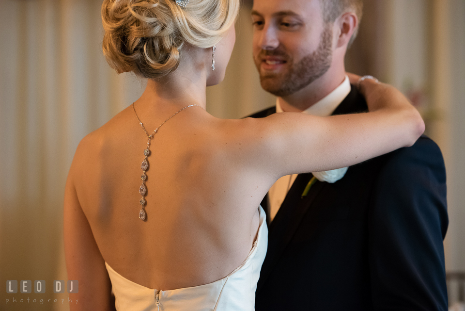 Bride embracing Groom during first look showing her backdrop necklace. Kent Island Maryland Chesapeake Bay Beach Club wedding photo, by wedding photographers of Leo Dj Photography. http://leodjphoto.com