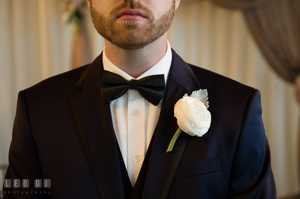 Groom with his white rose boutonniere. Kent Island Maryland Chesapeake Bay Beach Club wedding photo, by wedding photographers of Leo Dj Photography. http://leodjphoto.com