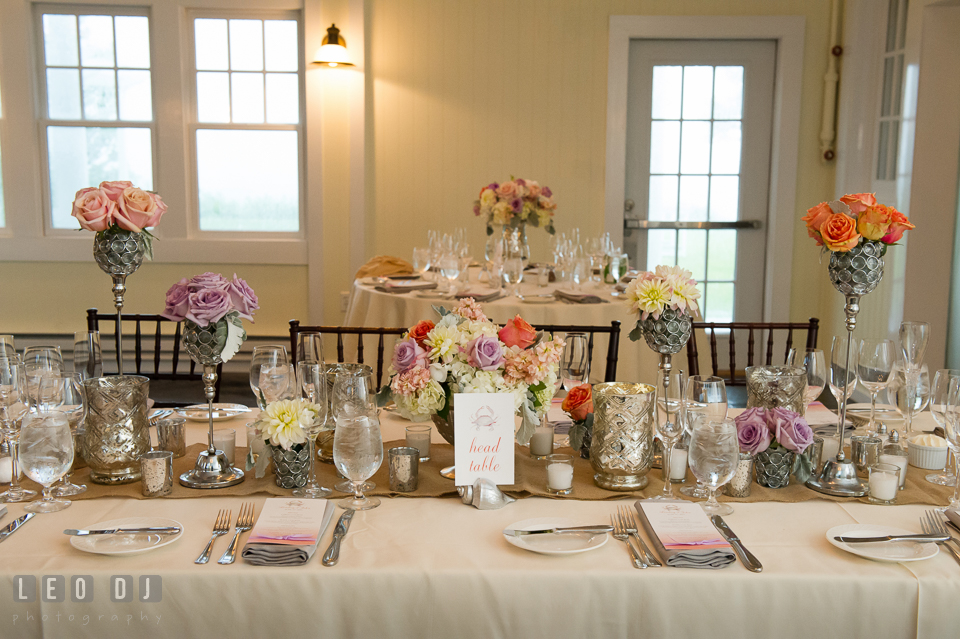 Head table centerpieces with various vases from Lauren Niles and My Flower Box Events. Kent Island Maryland Chesapeake Bay Beach Club wedding photo, by wedding photographers of Leo Dj Photography. http://leodjphoto.com