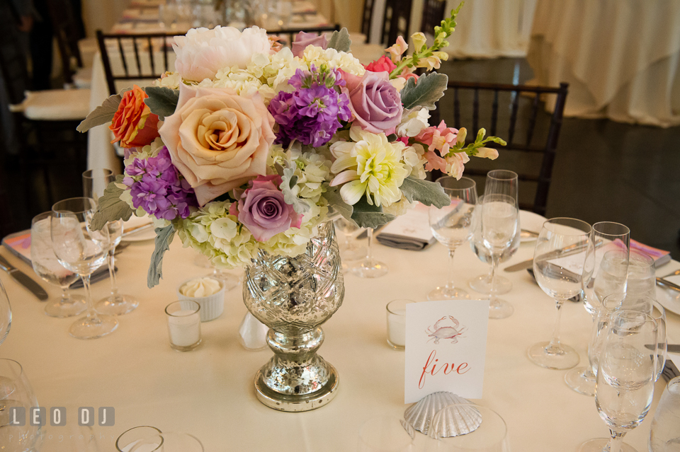Flower table centerpiece and table number with crab illustration. Kent Island Maryland Chesapeake Bay Beach Club wedding photo, by wedding photographers of Leo Dj Photography. http://leodjphoto.com