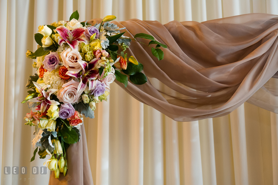 Flower arrangement on ceremony arch by Lauren Niles and My Flower Box Events. Kent Island Maryland Chesapeake Bay Beach Club wedding photo, by wedding photographers of Leo Dj Photography. http://leodjphoto.com