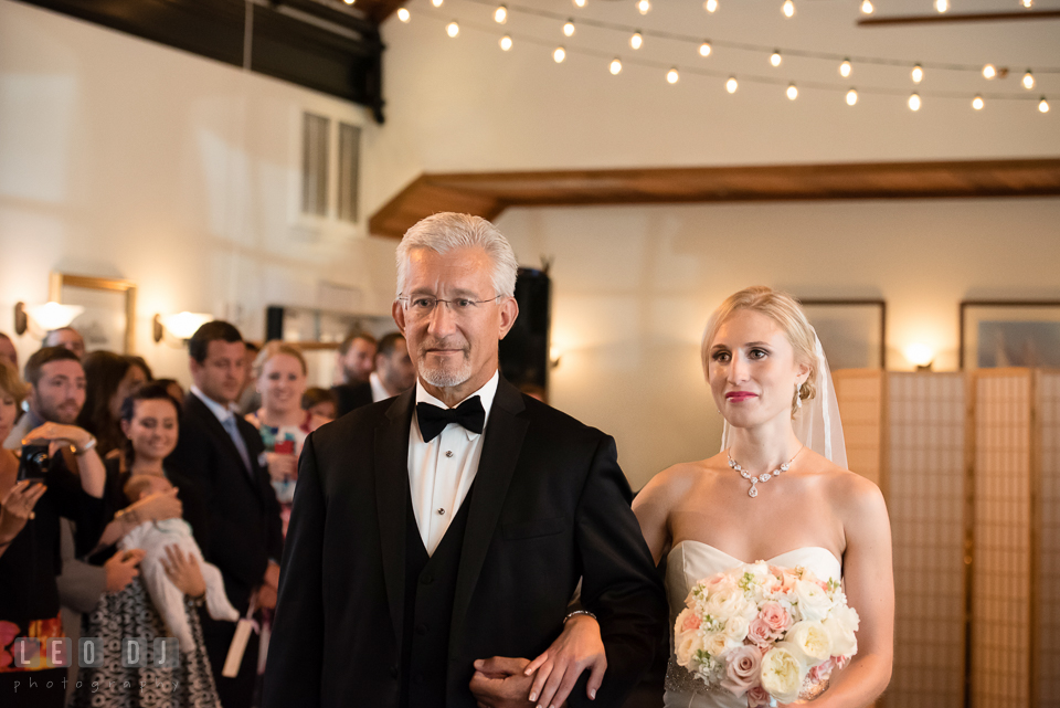 Father of the Bride escorting daughter during ceremony processional. Kent Island Maryland Chesapeake Bay Beach Club wedding photo, by wedding photographers of Leo Dj Photography. http://leodjphoto.com