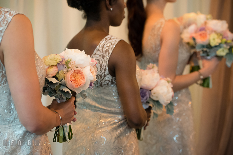 Bridesmaids during ceremony holding floral bouquets from My Flower Box Events. Kent Island Maryland Chesapeake Bay Beach Club wedding photo, by wedding photographers of Leo Dj Photography. http://leodjphoto.com
