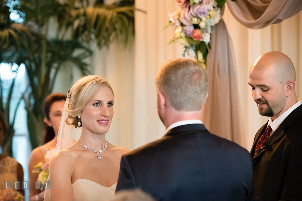 Bride reciting vows to Groom during ceremony. Kent Island Maryland Chesapeake Bay Beach Club wedding photo, by wedding photographers of Leo Dj Photography. http://leodjphoto.com