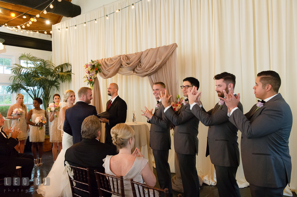 Officiant Rev. Tim Mulosmanaj from Ceremony Officiants explained to everyone why the fourth finger is chosen as the ring finger. Kent Island Maryland Chesapeake Bay Beach Club wedding photo, by wedding photographers of Leo Dj Photography. http://leodjphoto.com