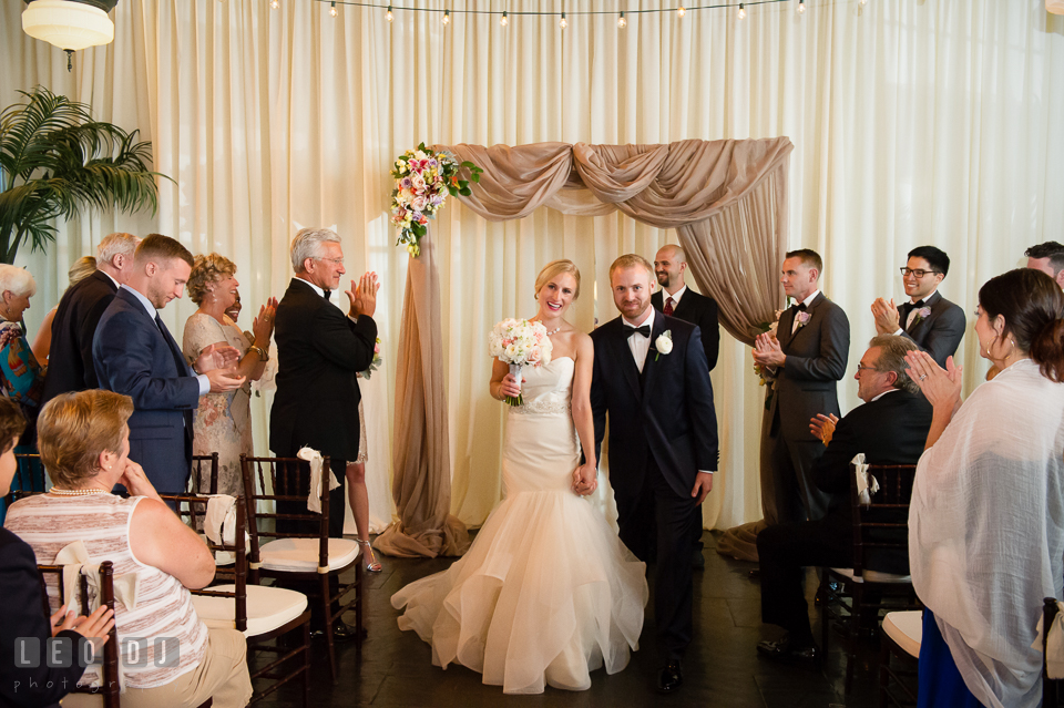 Bride and Groom walk out of the aisle after ceremony. Kent Island Maryland Chesapeake Bay Beach Club wedding photo, by wedding photographers of Leo Dj Photography. http://leodjphoto.com