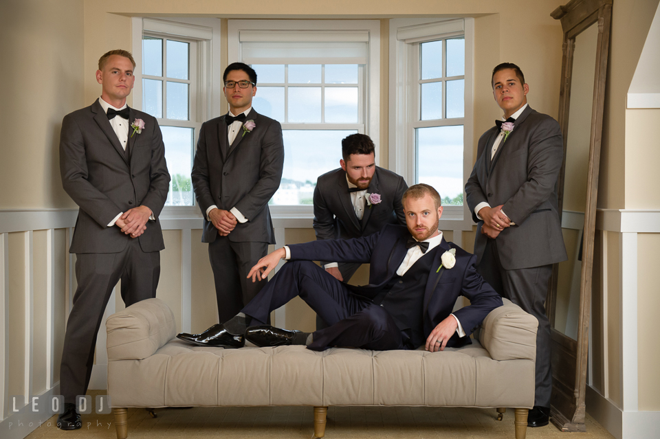 Groom lounging on the couch with Best Man and Groomsmen. Kent Island Maryland Chesapeake Bay Beach Club wedding photo, by wedding photographers of Leo Dj Photography. http://leodjphoto.com