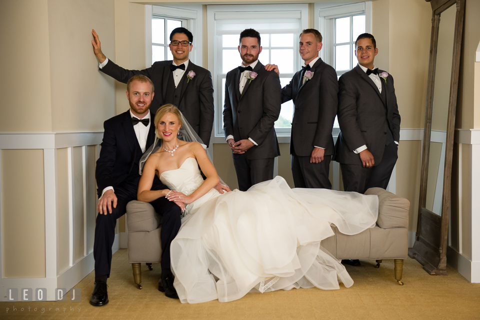 Bride and Groom posing with grooms party. Kent Island Maryland Chesapeake Bay Beach Club wedding photo, by wedding photographers of Leo Dj Photography. http://leodjphoto.com