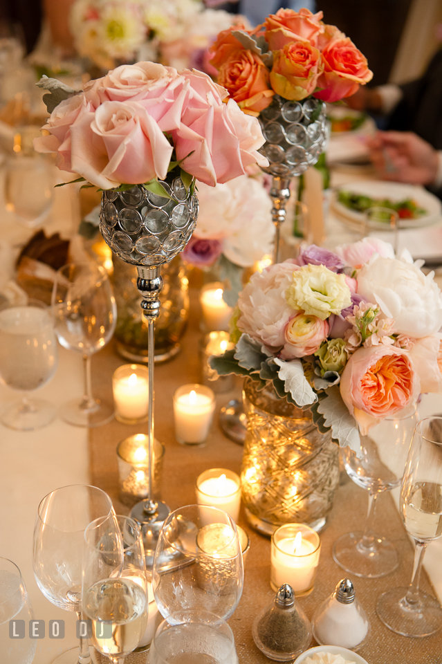 Pink, orange and pastel colored flower table centerpieces with candles. Kent Island Maryland Chesapeake Bay Beach Club wedding photo, by wedding photographers of Leo Dj Photography. http://leodjphoto.com