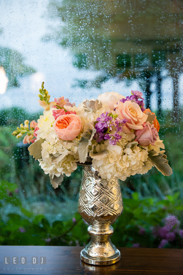 Pink roses with with hydrangea on silver vase against a wet window from the rain. Kent Island Maryland Chesapeake Bay Beach Club wedding photo, by wedding photographers of Leo Dj Photography. http://leodjphoto.com