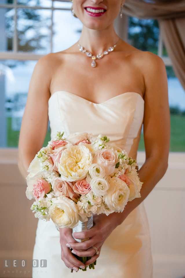 Bride holding a large flower bouquet of white and pink roses. Kent Island Maryland Chesapeake Bay Beach Club wedding photo, by wedding photographers of Leo Dj Photography. http://leodjphoto.com