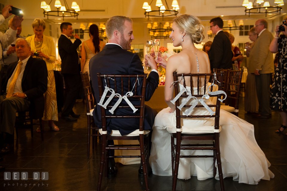 Bride and Groom at the head table toasting their champagne drinks. Kent Island Maryland Chesapeake Bay Beach Club wedding photo, by wedding photographers of Leo Dj Photography. http://leodjphoto.com
