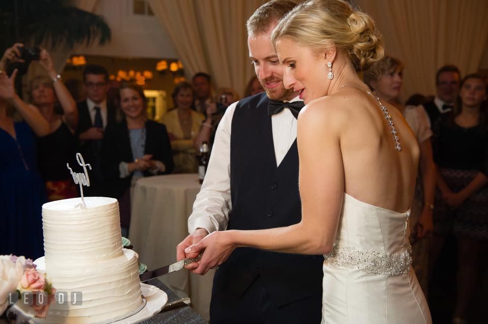 Bride and Groom cutting the cake. Kent Island Maryland Chesapeake Bay Beach Club wedding photo, by wedding photographers of Leo Dj Photography. http://leodjphoto.com