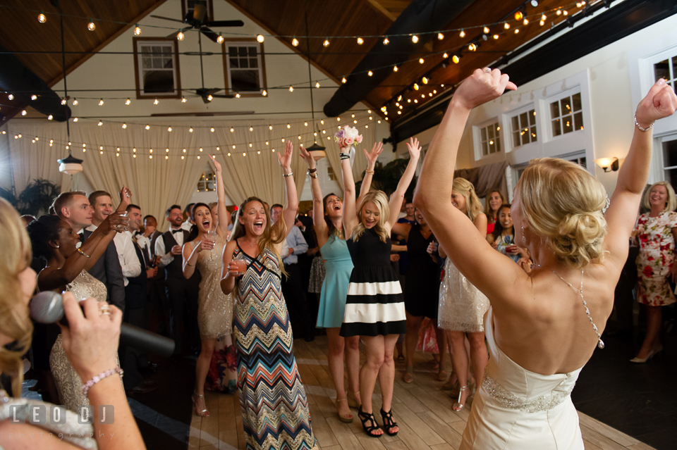 Bride and guests cheered after one guest caught the flower bouquet tossed. Kent Island Maryland Chesapeake Bay Beach Club wedding photo, by wedding photographers of Leo Dj Photography. http://leodjphoto.com