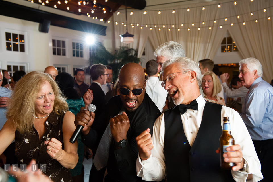 Father of the Bride and guest singing along with singer from Onyx band. Kent Island Maryland Chesapeake Bay Beach Club wedding photo, by wedding photographers of Leo Dj Photography. http://leodjphoto.com